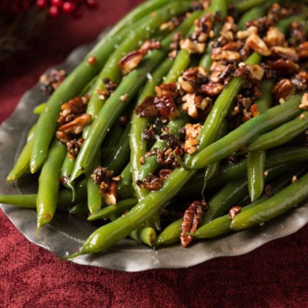 Green beans have a certain suave, slender elegance that makes them a classic                   accompaniment to rosy-red roast beef. But too often, they get short shrift: a                   quick drizzle of butter, a squirt of lemon, and onto the table they go. We                   suggest you coddle them a little this year. Try tossing them in a hot skillet                   with shallots and pecans that get caramelized in buttery brown sugar, and                   you'll see just how…