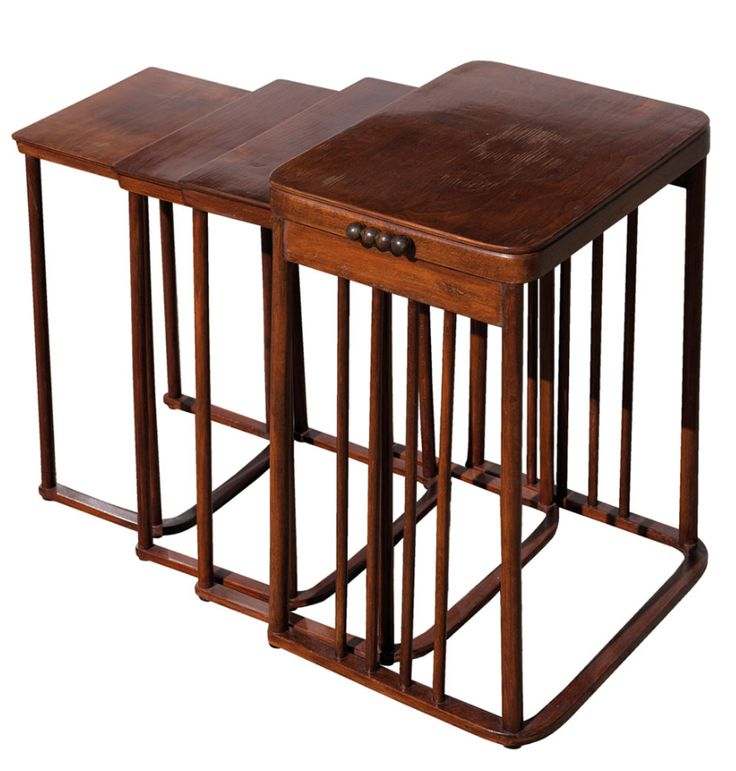 Josef Hoffmann. Nesting tables, ca. 1905. Kohn model no 986. Four hooked nesting tables, H. 64.5-75.5 cm; 60-34.3 x 42.8-27.3 cm. Made by: J. & J. Kohn, Vienna. Bent- and Plywood (Beech). Original manufacturers label: J. & J. Kohn on the bottom side of the small table, hallmark is hard to read... OLD.