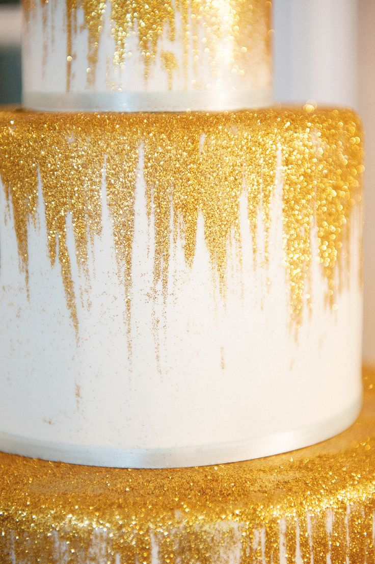 Wedding Cake Dripping in Glitter! More whimsical inspiration on SMP:  http://www.StyleMePretty.com/mid-atlantic-weddings/2013/08/26/peter-pan-wedding-inspiration-from-evelyn-alas-photography-charm-city-cakes/ Evelyn Alas Photography | Cake by Charm City Cakes