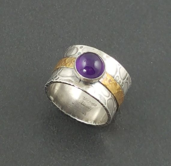 Sterling silver has been roll printed to add texture. A decorative brass strip of roll printed wire is soldered to the silver. An amethyst stone is then added. The whole piece is then oxidized to bring out the detail. The ring measures approx 1/2 wide and is a size 7. It can not be resized. Not sure of your ring size? See my listing for my handy ring sizer: http://www.etsy.com/listing/64250190/reusable-adjustable-ring-sizer  To see more rings: http://ww...