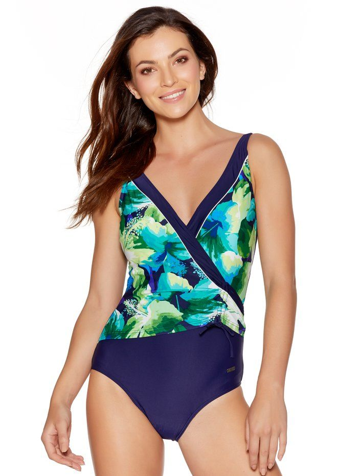 Naturana Tummy Control Wrap Swimsuit.  Specially designed with a striking v-neckline and scoop back, this wrap swimsuit by Naturana makes a statement in your holiday wardrobe. With adjustable shoulder straps and lightly padded cups, the slimming control panel contours your tummy creating an enviable silhouette.