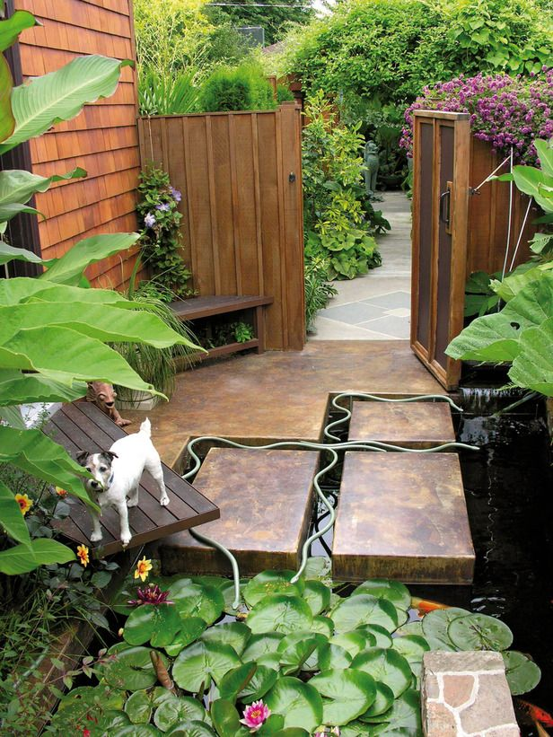 Eclectic Garden Design: Thin metal snakes wriggle between paving and into a pond in this small section of a garden by U.S. landscape designer Michael Schultz. From HGTV.com's Garden Galleries