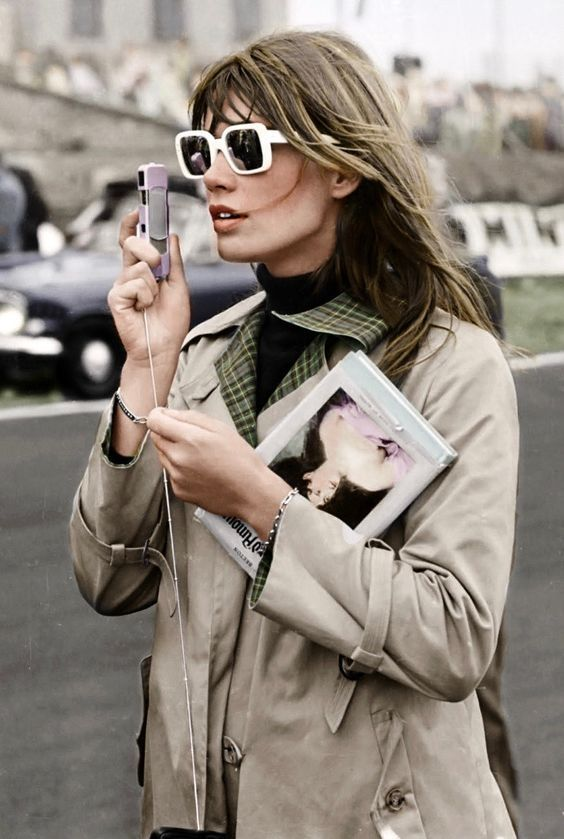 Classic never fails! Classic taupe trench coat styled with white square statement frames. Love it!