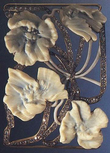 Lalique 1902 signed 'Hawthorne' Dog Collar Plaque: an openwork plaque set w/four carved French ivory hawthorn flowers, each stained w/blue, w/white enamel stems, old European-cut diamond undulating ribbon motif, mounted in 18k gold. christies.com