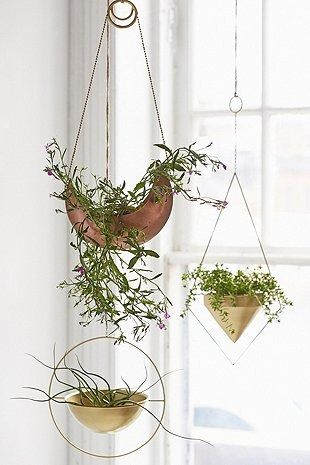 Bang on trend – copper hanging planters from Urban Outfitters UK.