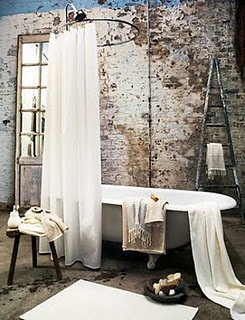 Sweet shower curtain & exposed brick wall