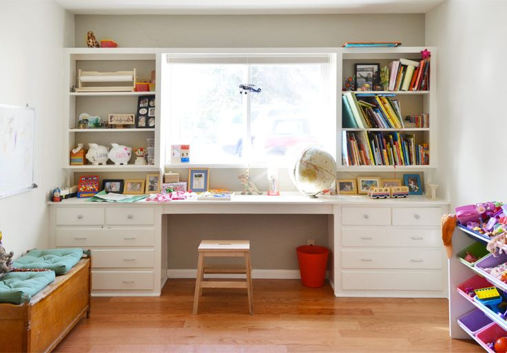 The Finley Drive Residence located in Central Austin: Colorful kids room with twin beds, desks and plenty of toys and books to play with.