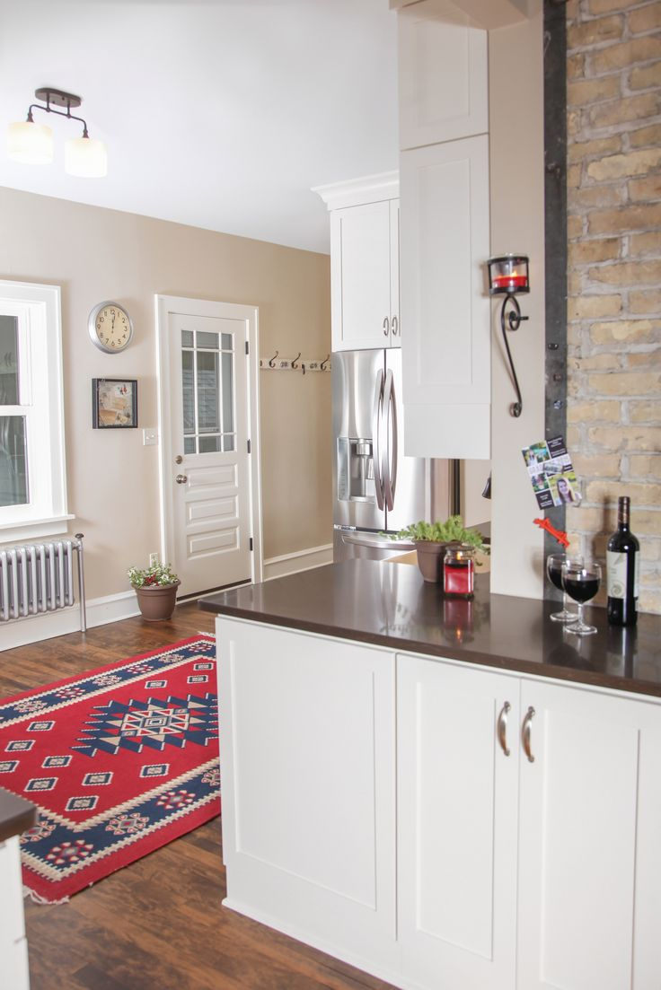 transitional kitchen white painted cabinetry with caesarstone countertop tops stainless steel appliances and hardwood flooring: kitchen cabinets home office transitional