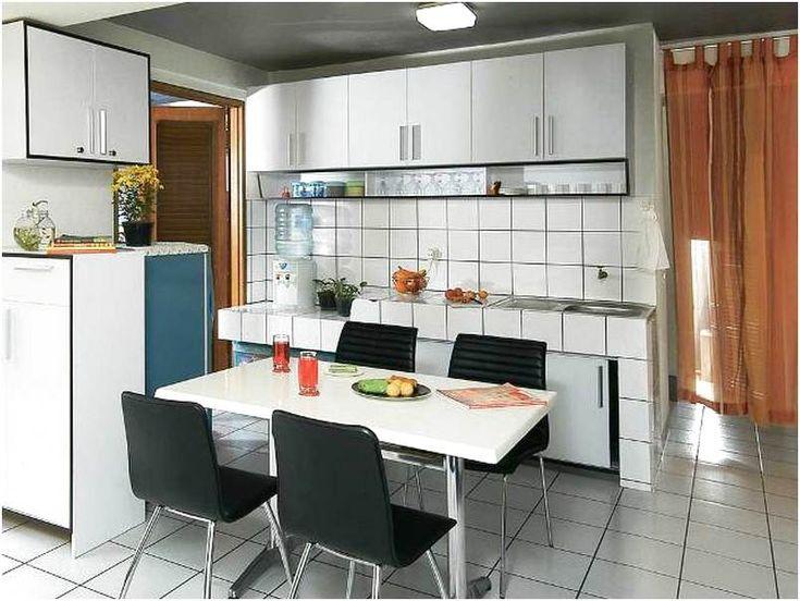 Desain ruang makan menyatu dengan dapur minimalis mewah sederhana