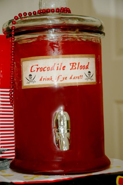 Another great idea for a Pirates themed birthday party!!! Crocodile blood... A.k.a. Fruit punch lol
