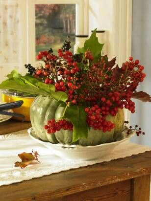 Rosehips and pumpkins make a great pair--a little foliage too and it's ready to…