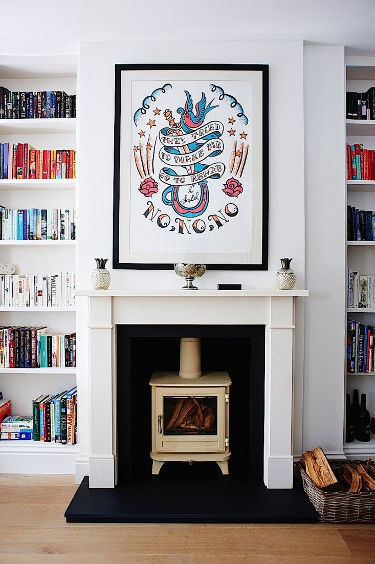 Sainsbury Chesney Multi-fuel stove in fireplace of Isabel and George Blunden London renovation | Remodelista {this is a great house}