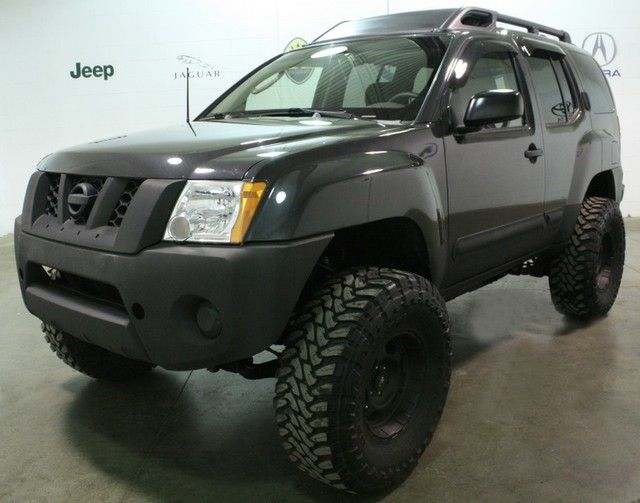 "Xterra with 4"" suspension lift and 2"" body lift. 