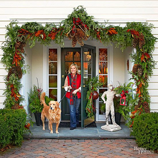 Welcome holiday guests to your home in style with a grand entryway garland. String a garland with fresh evergreen boughs, and use oversize pine cones, vintage trophies and a huge plaid bow to form a magnificent focal point. Swag the door with more greenery for a wow-worthy first impression. Editor's Tip: If your front door garland is weighty, hang it from screw-secured hooks mounted around your entryway. For lighter garlands, sticky-backed removable hooks provide a stable (and temporary!)…
