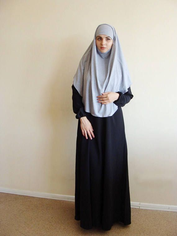 The original model of thetraditional hijab in grey melange jersey. Dresses quickly and easily! In this hijab, curtains for fixation on the head are used. Asymmetric shape - rear cornered. This handy headdress like those who do not yet know how to wind a scarf, busy mums and female students. It is simple and concise, suitable for study, work and walks.  I can make in any color to any of your outfit, also we can make it longer and shorter if you want. I would be glad if you will cover our…