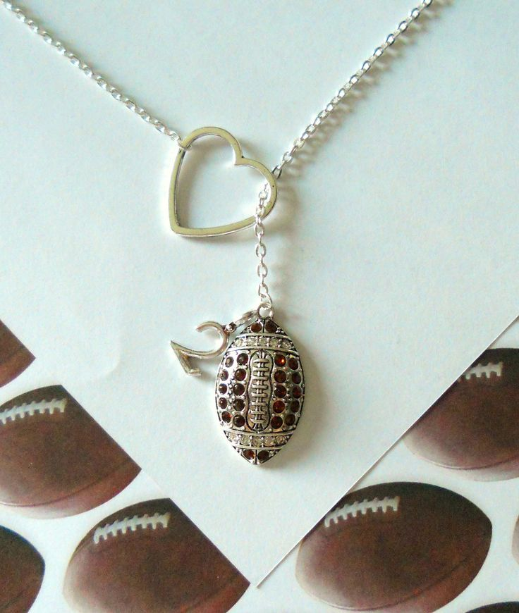 For my Football Mom's--How cute is this?  Football Necklace with Rhinestones and Heart and Number, handmade jewelry. $27.50, via Etsy.