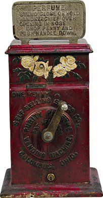 1 Cent Self Selling Sales Co. Purity Perfume Vending Machine Perfume Sprayer c1910, cast-iron case.  The perfume is sprayed out of the embossed roses at the top of the machine, in excellent original condition, rare w/ keys - 7w x 5d x 14h