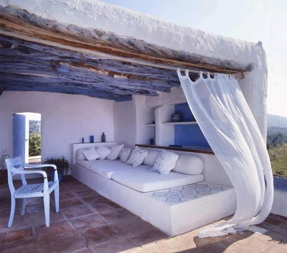 beautiful relaxing area! love the curtain on the wind! blue with white very Greek!