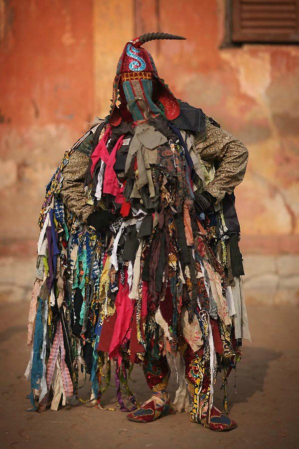 Ouidah, Benin, voodoo ceremony - Egungun spirits This guy is serious, those are glad rags.