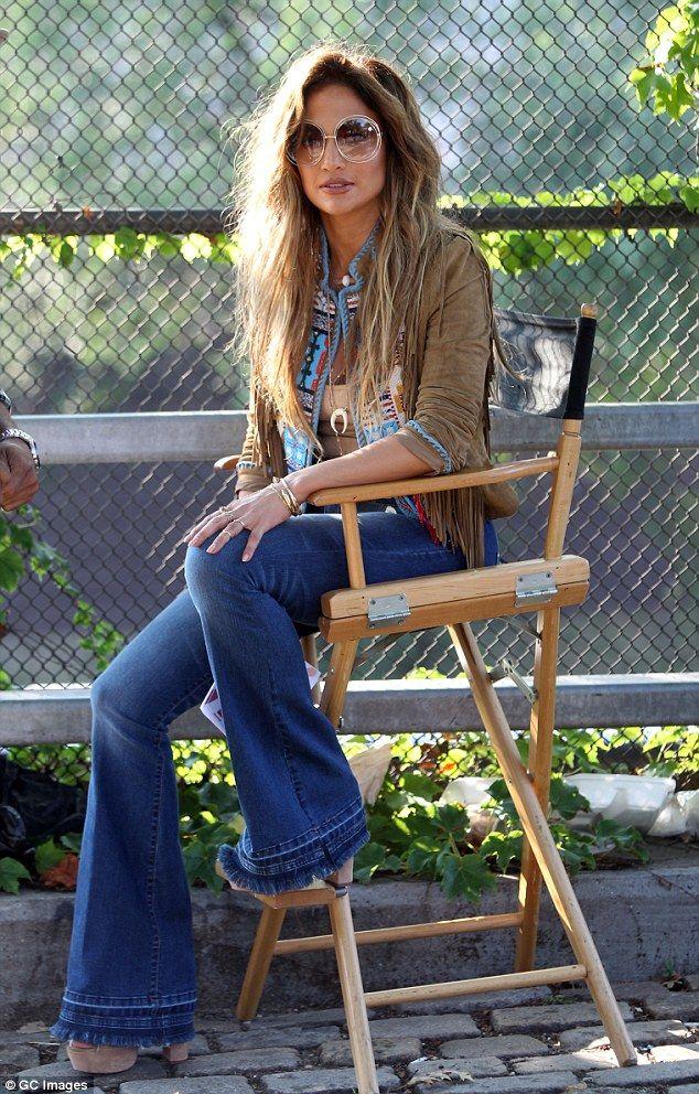 Booty-licious! Jennifer Lopez Models Flared Jeans Like No Other | Buy ➜ http://shoespost.com/jennifer-lopez-music-video-70s-gladiator-sandals-platform-flared-bell-bottom-jeans/