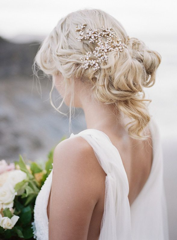 Messy has never looked this good. Flawlessly curled hair meets an entire bottle of hairspray for this fun and dramatic 'do. Add a statement piece to pull the look together (literally) and you have the most fab wedding hair. Courtesy of Archetype Studio
