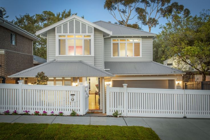 This luxury modern weatherboard home was custom designed to perfectly complement the sloping block.