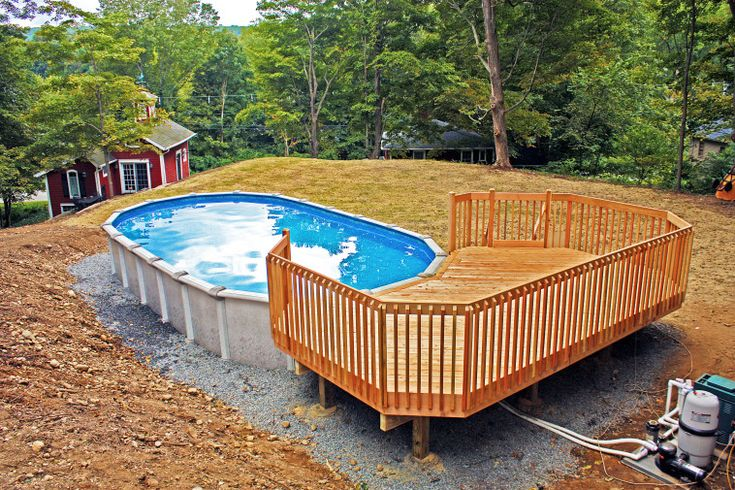 Above ground oval pool which completed with laminated oak for Above ground pool decks and fencing