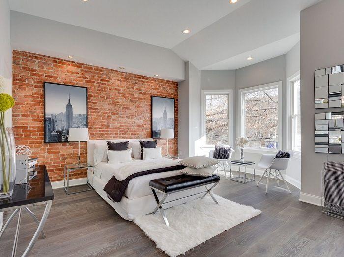 Тёплый естественный цвет кирпича в союзе с текстилем в черно-белых тонах гармоничен при оформлении спальни.