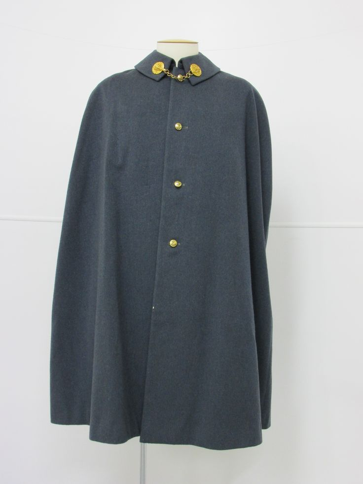 Royal Air Force Ceremonial Cape, circa 1953. The Queen's Crown and eagles have been stamped onto the small brass buttons. From the collection of the Air Force Museum of New Zealand.