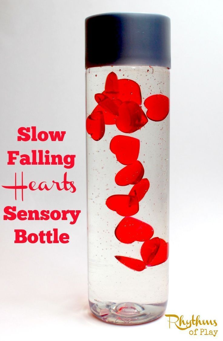 """Slow falling hearts sensory bottle is the perfect Valentine's Day calm down jar. Discovery bottles like this are commonly used for no mess sensory play, to help calm an overwhelmed child, as a """"time out"""" timer, or as a meditation technique for children. They are just as effective for adults."""