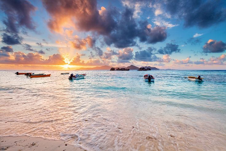 La Passe by Michael  Breitung on 500px Sun sets behind Praslin island, photographed from the little harbour in La Digue. Great colors that evening which was our last one on la Digue