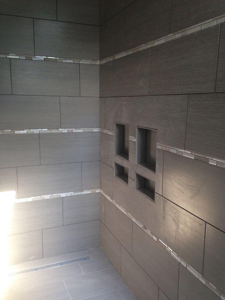 Custom tiled shower with 12x24 tile installed horizontally ...