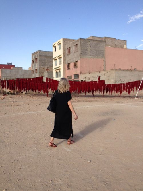 Mr. Salimi is drying the dyed wool-yarn  in the sun outside his work-shop in a small village in the southern part of Morocco