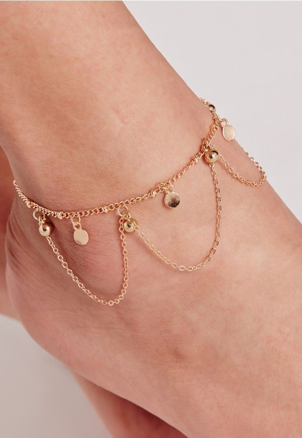 Add a touch of chic to your summer look with this delicate gold anklet. With charm detailing and drop chain finish, this beaut will add an edge to your poolside look for goddess vibes! #goldanklet
