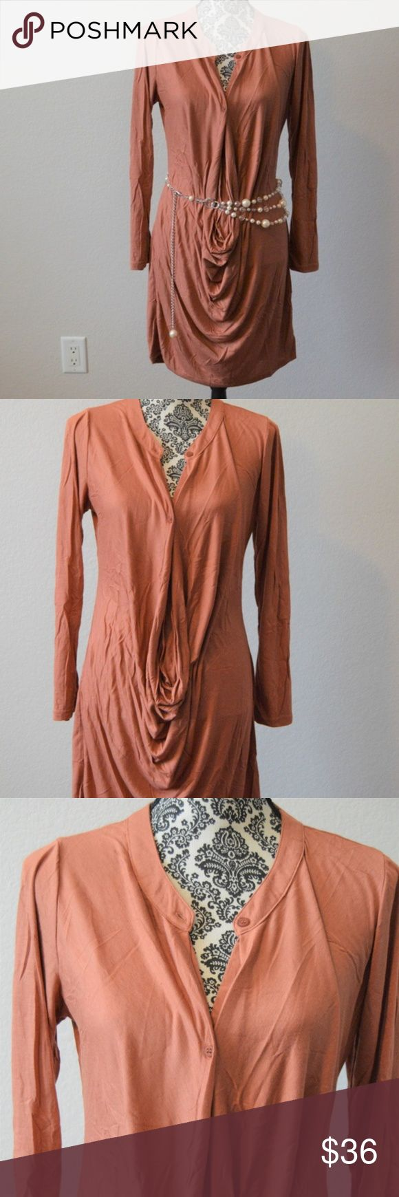 !!!NEW ARRIVALS!!! Long Sleeve Dress Blush Camel long sleeve, crew neckline that buttons down the front into a long cowl neck.  Dress hits right above the knee. 95% rayon/5% spandex. Dresses Long Sleeve