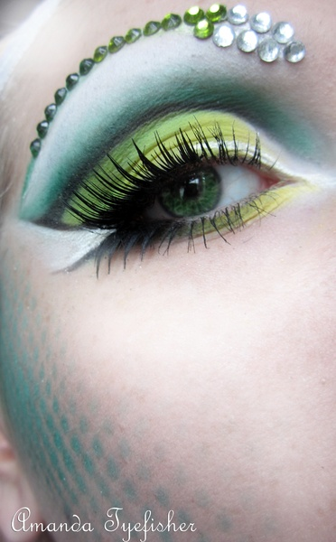GlamSnake.  Sweet pastel eye shadow.   Chartreuse aqua white eye shadows with green gem eye jewels on eye brows.   Fantasy make up