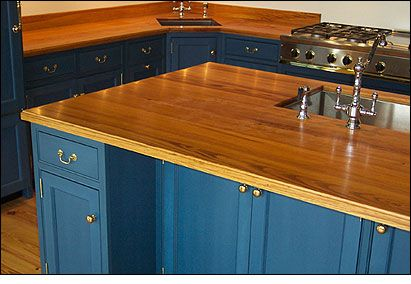 blue kitchen countertops | Pine countertops contrast beautifully with blue kitchen cabinets in ...