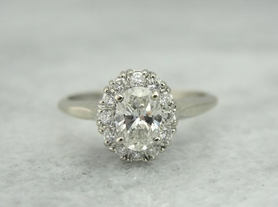 Classic Halo Engagement Ring with Oval Cut Center Diamond RGDI1102N