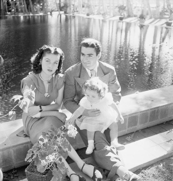 Shah Mohammed Reza Pahlevi of Iran with his first wife, Queen Fawzieh, and their daughter, Princess Chahnaz photographed in Teheran, c. 1944