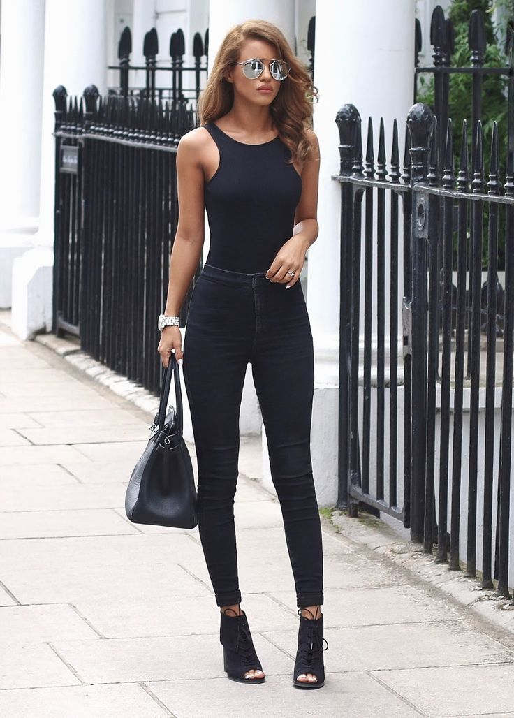 25 Bodysuit Outfit Ideas for Summer | Cute black bodysuit styled with black high-waisted skinny jeans and lace-up peep toe ankle boots @stylecaster