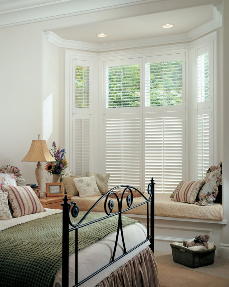 Try wooden shutters in bedroom? Exterior, : Exquisite Picture Of Living Room Decoration With Bay Window Seating In Bedroom Along With Curved Black Wrought Iron Foot Board And White Wood Indoor Window Shutter