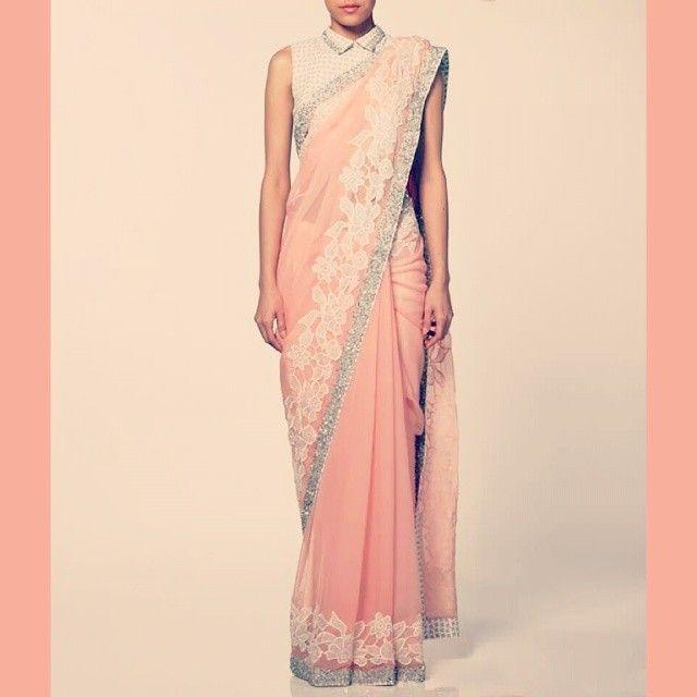 A vintage saree by @neeta_lulla in lovely salmon pink flat chiffon saree with a sleeveless houndstooth blouse. #neetalulla #czarinaofindianfashion #online #saree #houndstooth