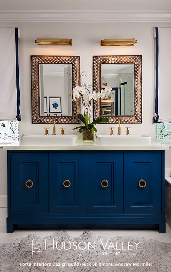 Bring the unexpected into your bathroom. Go for the colors you crave. And when it comes to lighting? Be brave. Here, our Merrick picture light serves as a vanity sconce. You can find more here.