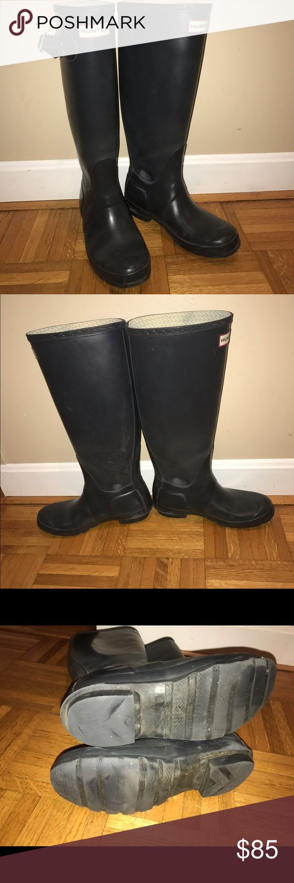 Navy blue women's Hunter Boots Size 5F (euro 35/36) women's Hunter boots in Navy blue. These are the matte finish, tall style. Some signs of wear on the insides of the boots but do not notice it when worn. One of the buckles did rip but is still on the boot. Excellent shape otherwise. Fit very large, these fit me a bit snug but I wear a 7.5-8 normally. Size on listing is reflective of the European size as I feel it is more accurate. Hunter Shoes Winter & Rain Boots