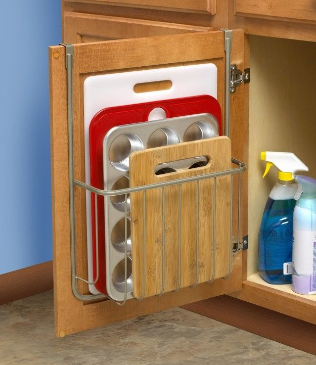 This over-the-cabinet organizer so your cutting board doesn't have to get crammed into a drawer or oven hole. | 25 Useful Things That Will Actually Help You Get Your Shit Together