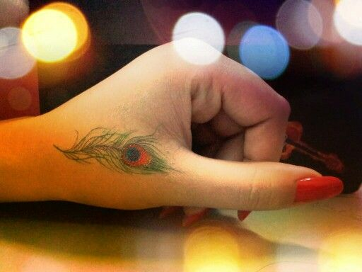 Peacock feather  tattoo                                                       …