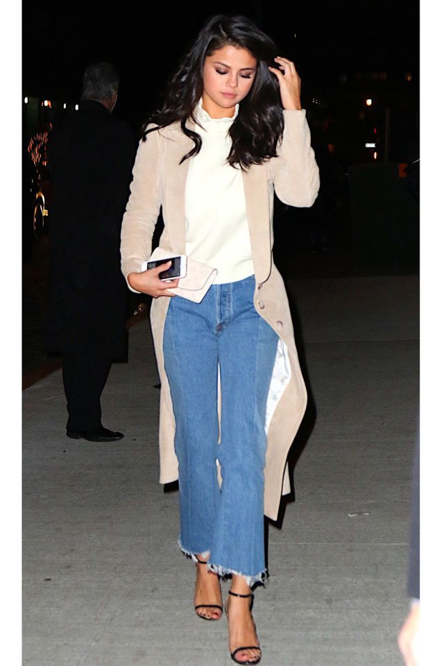 In a Wes Gordon suede camel coat draped over an off-white turtleneck and frayed kick flares for dinner at Nobu in NYC.   - HarpersBAZAAR.com