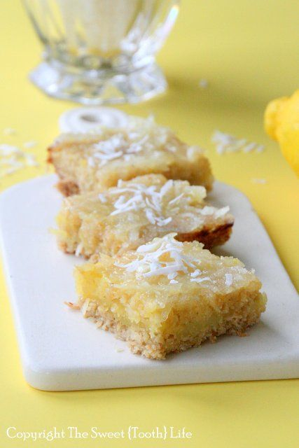 Gluten and dairy free lemon bars with a coconut twist! Thick crust, creamy filling, and tangy topping makes these irresistible!
