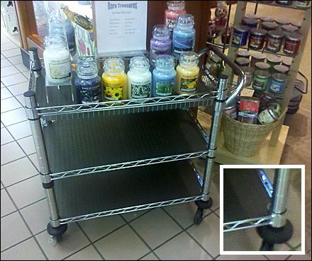 Wheeled to the Mall entrance, this Metro-style Utility Cart as POP reaches out for just a little extra customer attention. Luckily it was not yet fully stocked for it reveals the shelf inserts or l...