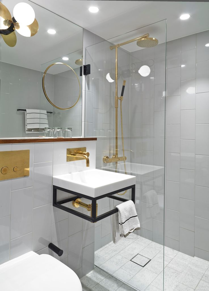 Bathroom with golden details - Clarion Hotel Amaranten